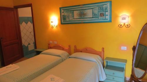 A bed or beds in a room at Il Viandante