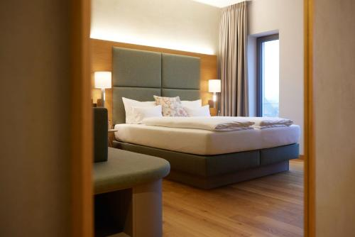 Ein Bett oder Betten in einem Zimmer der Unterkunft Hotel Rittergut Stoermede