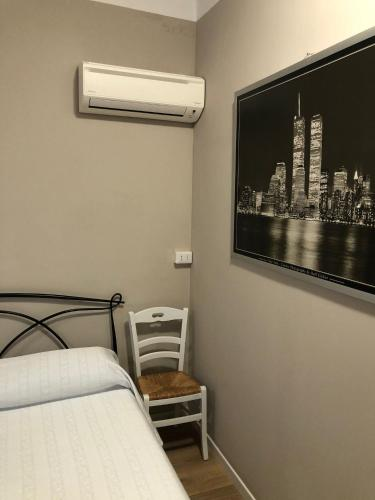 A bed or beds in a room at Loft a 2 minuti dall'aeroporto