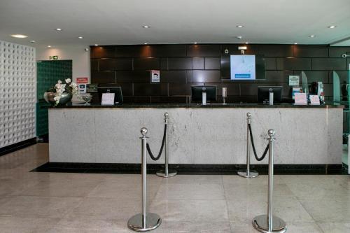 O saguão ou recepção de Castelo Inn Hotel