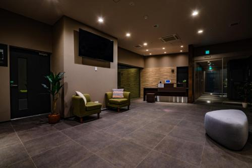 The lobby or reception area at Randor Residential Hotel Sapporo Suites