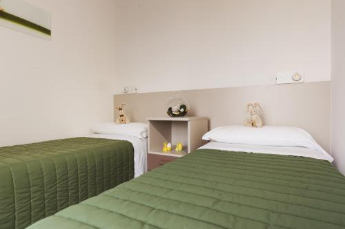 A bed or beds in a room at Piani di Clodia Holidaypark