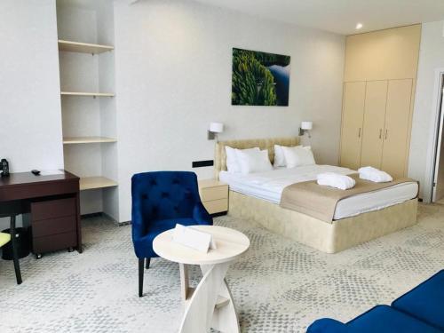 "A bed or beds in a room at Апарт-отель ""На Высоте"""