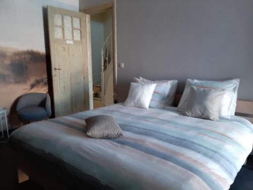 Een bed of bedden in een kamer bij 't Zandmanneke