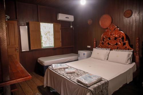 Ein Bett oder Betten in einem Zimmer der Unterkunft Amazonia Jungle Hotel