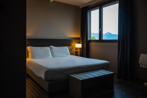 A bed or beds in a room at 57 Reshotel Orio