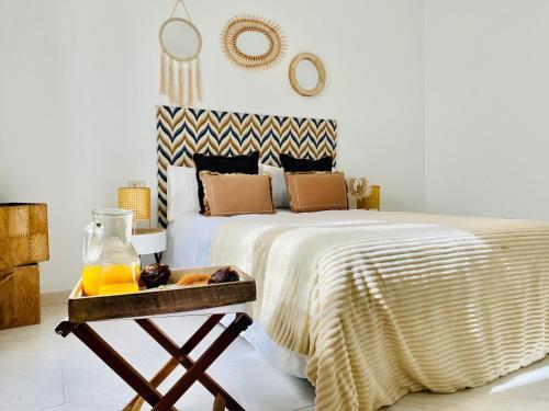 Un ou plusieurs lits dans un hébergement de l'établissement Famara Surfer Apartment