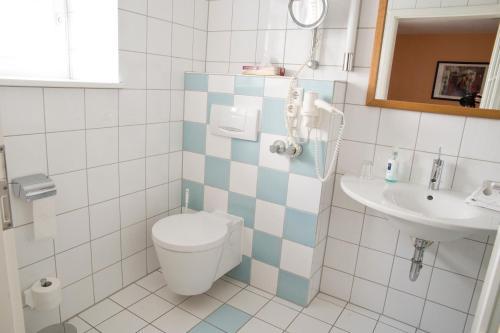 Ein Badezimmer in der Unterkunft Hotel Weber