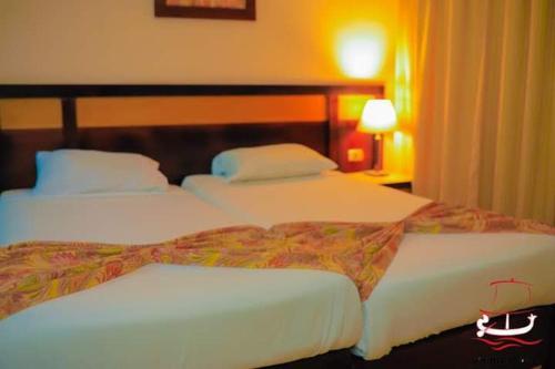 Ліжко або ліжка в номері Viking club sharm