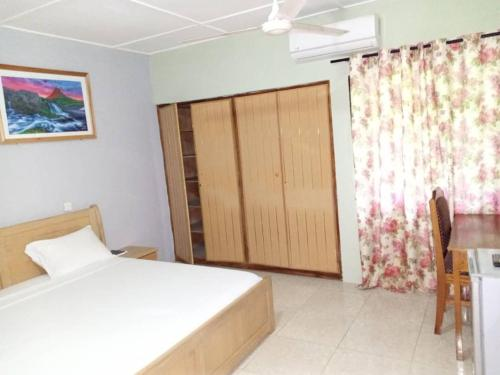 A bed or beds in a room at PANAASA GUEST HOUSE