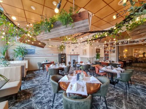 Een restaurant of ander eetgelegenheid bij Hotel Nap
