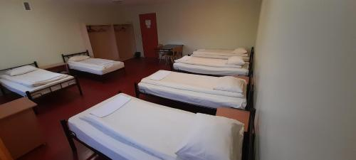 A bed or beds in a room at Hostel Brize