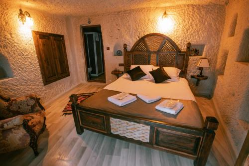 A bed or beds in a room at Mia Cappadocia Cave Hotel
