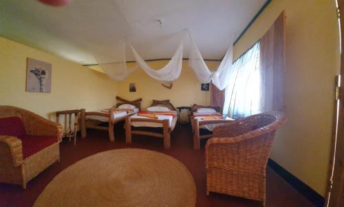 Restaurant ou autre lieu de restauration dans l'établissement Maasai giraffe eco lodge
