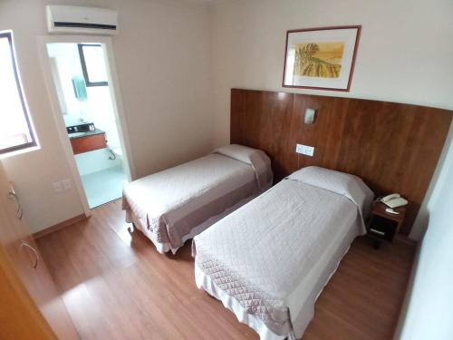 A bed or beds in a room at Guará Inn Flat Service