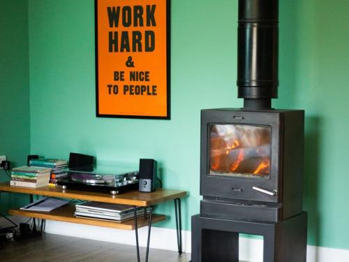 A television and/or entertainment center at The Hayloft - UK7200