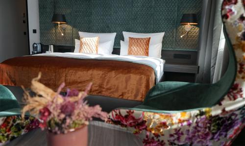 A bed or beds in a room at Boutique Hotel Germania
