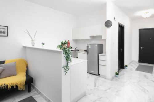 A cozinha ou cozinha compacta de استيديو اكاسيا Acacia Studio