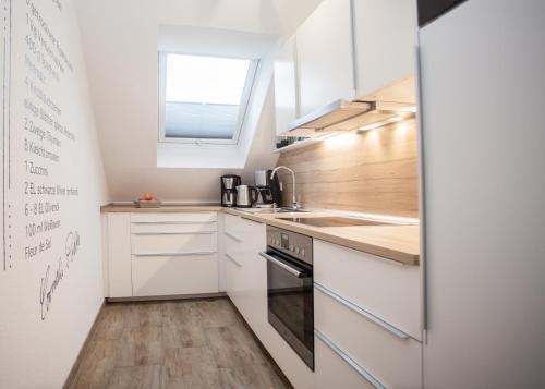 A kitchen or kitchenette at Ferienwohnung Winterberg-Perle