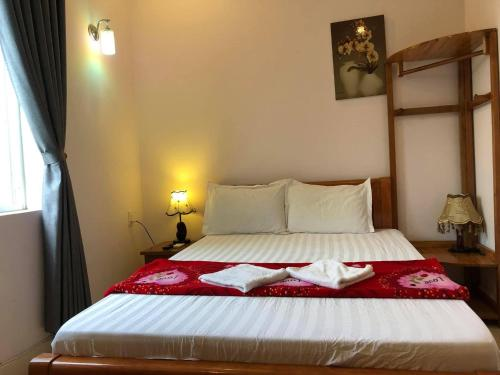 A bed or beds in a room at Bon Ami Hostel