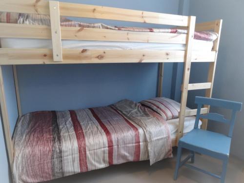 Een stapelbed of stapelbedden in een kamer bij B&B De BonAparte