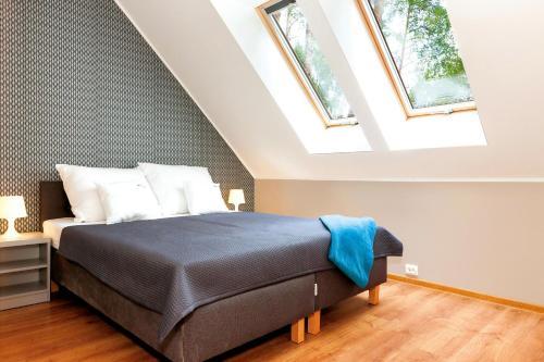 Łóżko lub łóżka w pokoju w obiekcie Apartamenty Villa Baltic Sun I