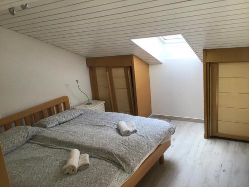 Krevet ili kreveti u jedinici u objektu Apartments Tomato