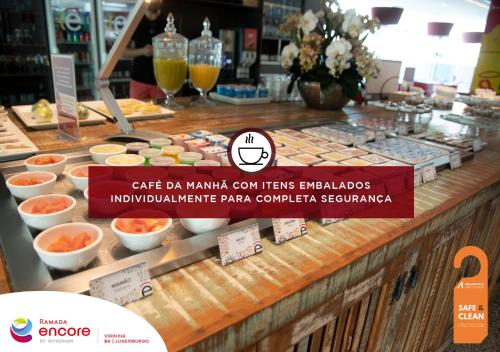 A restaurant or other place to eat at Ramada Encore by Wyndham Belo Horizonte Virginia Luxemburgo