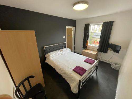 A bed or beds in a room at Bath YMCA Hostel