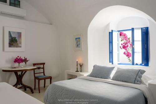 A bed or beds in a room at Aghios Artemios Traditional Houses