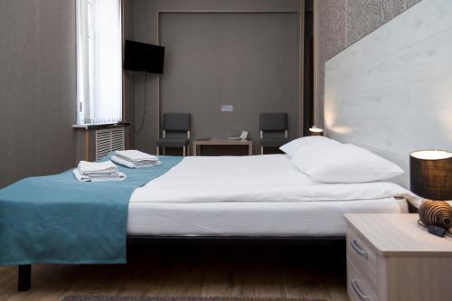 Кровать или кровати в номере Мини-отель Белелюбского