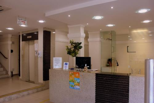 The lobby or reception area at Hotel Itajaí Tur