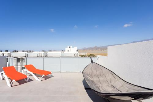 A balcony or terrace at 135 SOTAVENTO BLUE SKY Tejita Beach Experience by SUNKEYRENTS