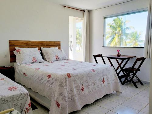 Cama ou camas em um quarto em Pousada Sol Nascente
