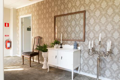 Ett badrum på Immeln Guest House
