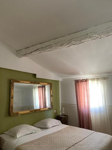 A bed or beds in a room at La Maison d'Odette