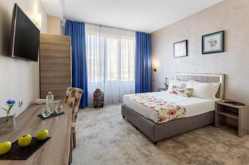 מיטה או מיטות בחדר ב-Prestige Boutique Hotel Craiova
