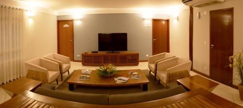 Uma área de estar em Hotel Costa Norte Massaguaçu