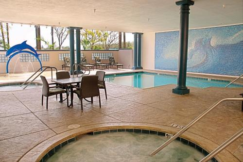 The swimming pool at or near Peacock Suites