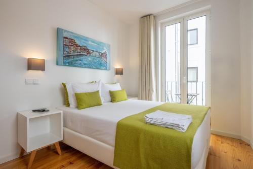 A bed or beds in a room at Mystay Porto Batalha