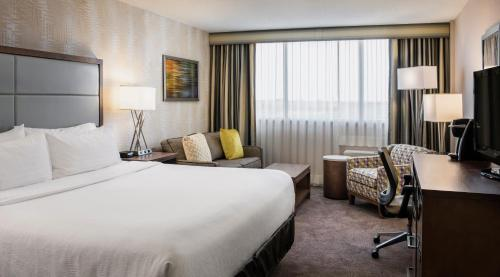 A bed or beds in a room at Holiday Inn Winnipeg-South, an IHG Hotel