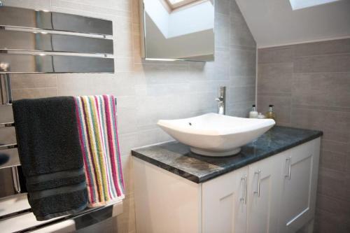 A bathroom at Homelands Apartment