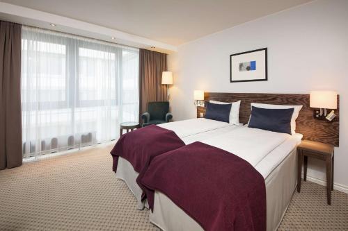 Cama o camas de una habitación en Scandic Neptun