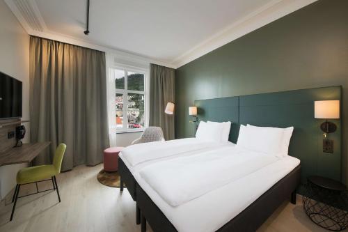 En eller flere senger på et rom på Scandic Torget Bergen