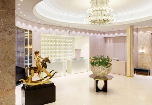 The lobby or reception area at Grand Hotel