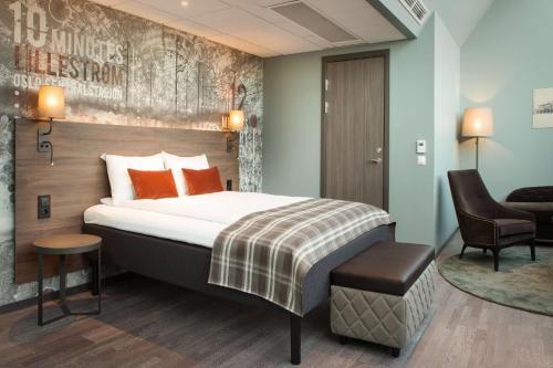 A bed or beds in a room at Scandic Lillestrøm