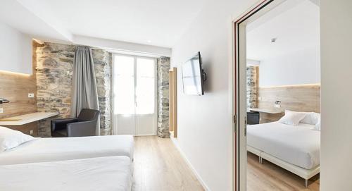 Un ou plusieurs lits dans un hébergement de l'établissement Hotel Bide Bide Tolosa