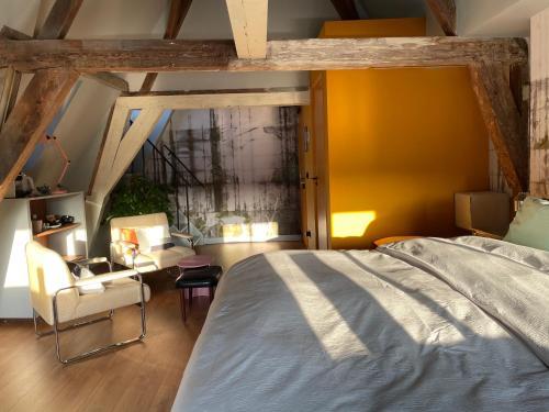 Een bed of bedden in een kamer bij Daen's Greenhouse