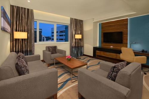 A seating area at DoubleTree by Hilton Hotel and Residences Dubai – Al Barsha