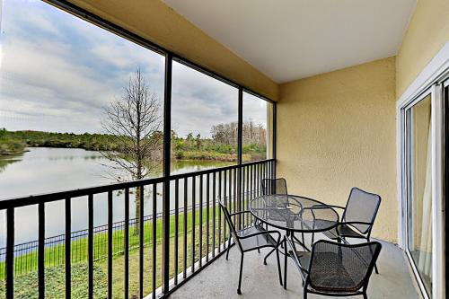A balcony or terrace at Dual-Suite Lake-View Escape - Mins to Disney World condo